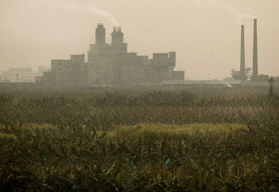 It's not uncommon to see industrial plants and factories border crop fields and rivers.